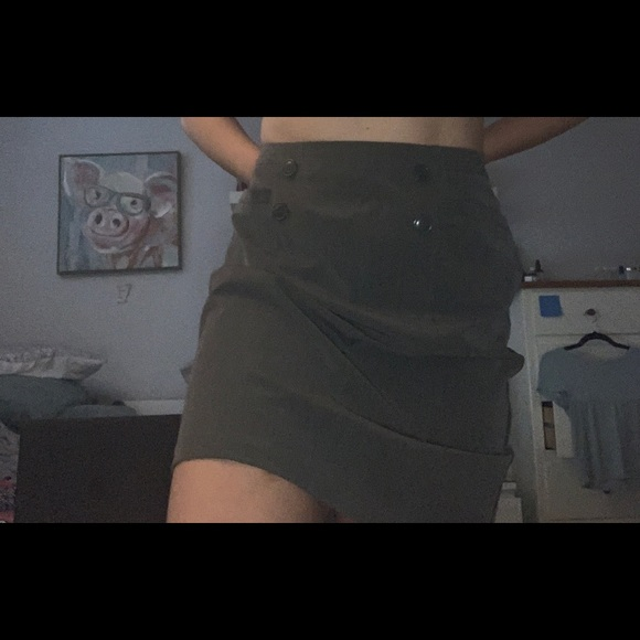 Grey skirt with buttons on the front.